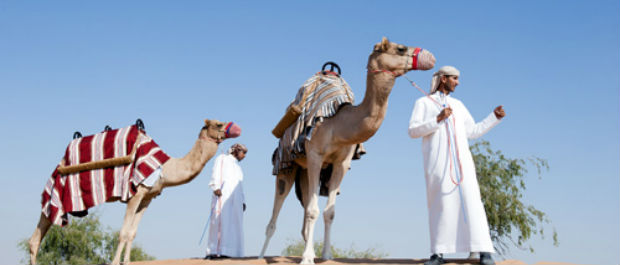 Taking a camel ride at Banyan Tree Al Wadi