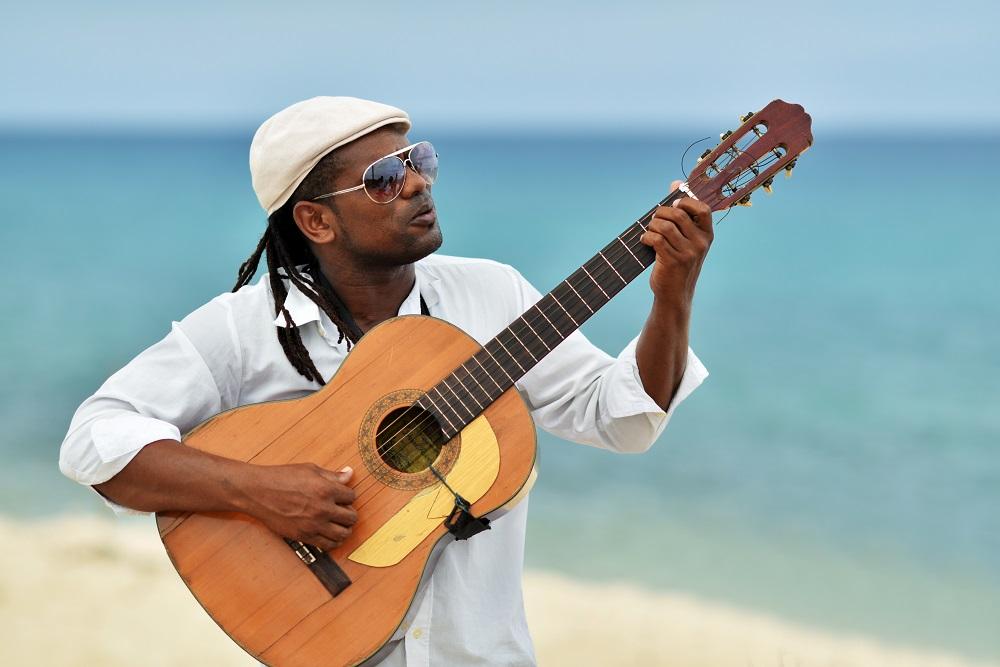 Caribbean man playing guitar